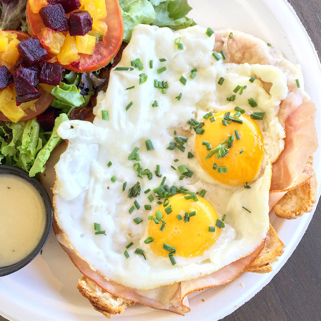 Brunch with two sunny side up eggs, ham, cheese, béchamel sauce on top of a croissant. I want to go to Paris so badly! #brunch #eggs