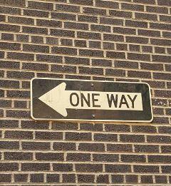 oneway building sign brick